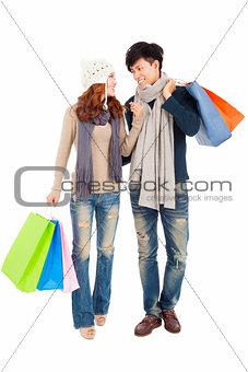 Happy couple doing shopping isolated on white