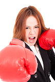 Businesswoman boxing punching towards and ready to fight