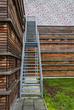 Steel stairs on a wooden building