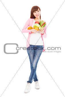 slim young woman holding fruits and vegetables