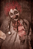 Clown doctor being strangled by autopsy limb