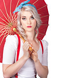 Dreamy blond pin up woman with parasol. Old style