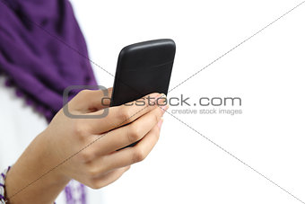 Close up of a hand of arab woman using a smart phone