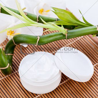 cosmetic face cream on wooden background