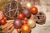 glittering christmas decoration in orange and brown natural wood