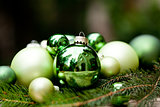 shiny green christmas baubles closeup macro and tree