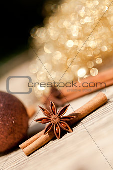 anice cinnamon and bauble christmas decoration in gold
