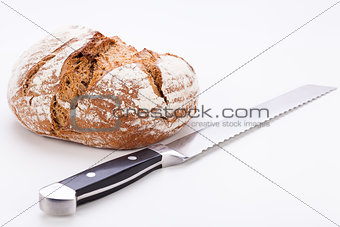 fresh baked grain bead and knife isolated