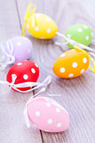 colorful easter egg decoration on wooden background