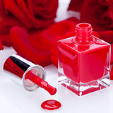 Elegant red nail varnish in a stylish bottle