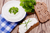 fresh tasty herbal creme cheese and bread