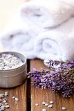 fresh lavender white towel and bath salt on wooden background