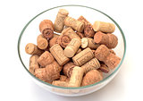 wine corks in bowl on white