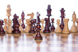 Chessboard with the focus on the pawn standing in the front