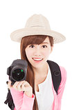 smiling young woman holding a  camera