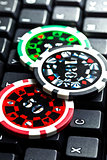 poker chips on computer keyboard
