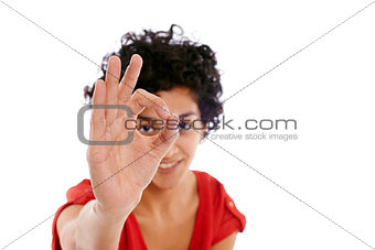 happy hispanic woman doing ok sign with hand