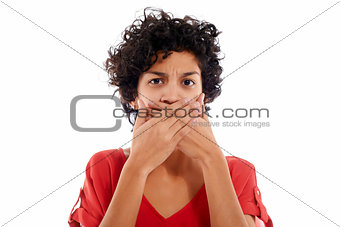 sad hispanic woman with hands on mouth