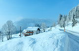 Morning winter misty rural alpine road and house
