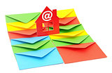 red plastic house shaped object on colorful envelopes white back
