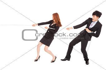 business man and woman playing tug of  war