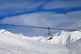 Chair lift and off-piste slope at nice day