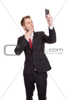 Businessman taking a selfie