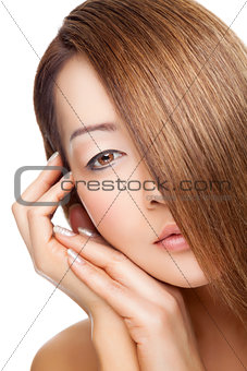 Beautiful young Thai woman with long elegant straight hair
