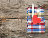 Cutlery set with colorful napkin and heart