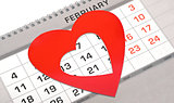 Red heart shape marker on calendar page showing February 14 Vale