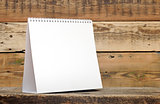 Blank calendar on wood table