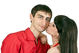 woman kisses a man on the cheek