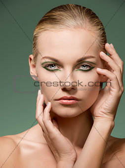 charming beauty girl with green make-up