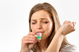 girl taking cough syrup