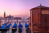 Romantic scenery of gondolas in Venice.