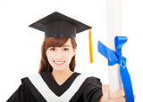pretty Young graduate girl student holding and showing diploma