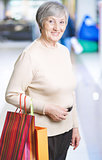 Mature woman with shopping bags