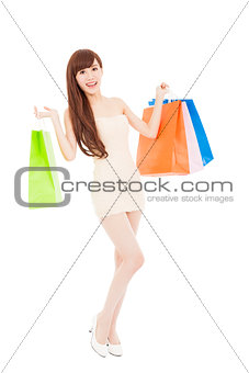 smiling and lovely asian woman with shopping bags