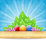Easter background with colorful eggs, leaves, flowers