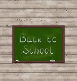 School green board on wooden texture