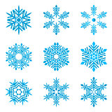 set of blue snowflakes on white
