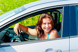 Portrait of a cheerful woman driving a car