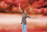 Composite image of happy woman jumping