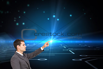 Composite image of businessman sitting and pointing the finger