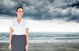 Composite image of content businesswoman posing