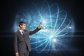 Composite image of smiling businessman holding something up in the air