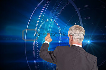 Composite image of rear view of stylish mature businessman pointing finger