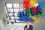 Composite image of businessman smiling at camera and holding blue umbrella