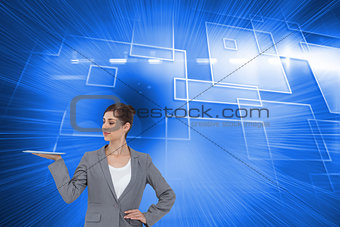 Composite image of businesswoman holding tablet computer