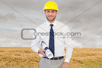 Composite image of cheerful young architect posing
